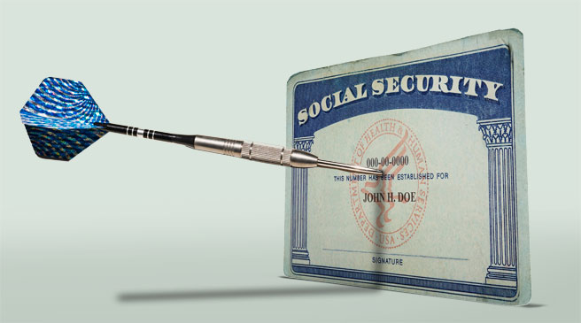 Image of a dart hitting a social security card