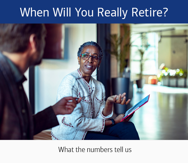 A woman sitting on a sofa, facing the camera, holding a notebook, speaking to a man who is facing away from the camera. The text at the top reads: When Will You Really Retire? The text at the bottom of reads: What the numbers tell us.