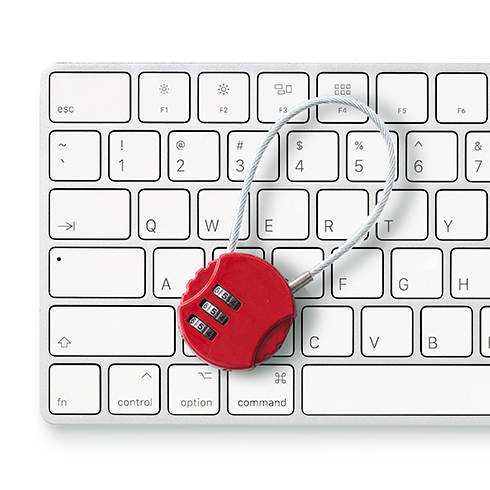 red wire computer lock resting on a keyboard