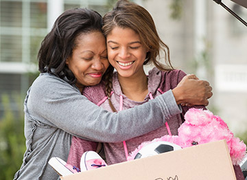 Article Image - A mother hugging her college-bound daughter. Find out what a 529 education savings account can cover.