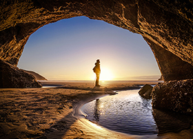 Article Image - Man watching sunrise while hiking
