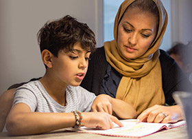 Article Image - Mother helping son with homework