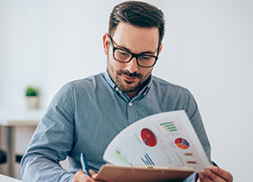 Article Image - Young man looking at investment charts