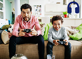 Article Image - Father and son playing video game