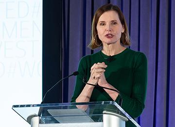 Article Image - Geena Davis speaking at a podium