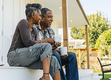 Article Image - A couple enjoying coffee on their back porch