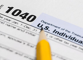 Article Image - Pencil on a 1040 tax form