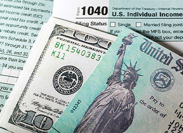 Article Image - Montage of tax forms, money, and U.S. tax return check