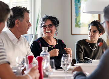Article Image - Family around a table enjoying time together