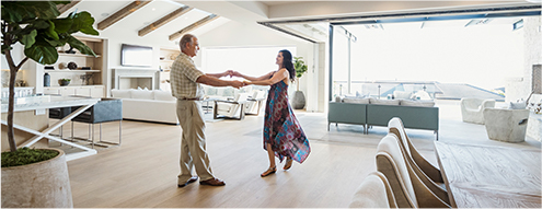 Image of a man and woman dancing in their home
